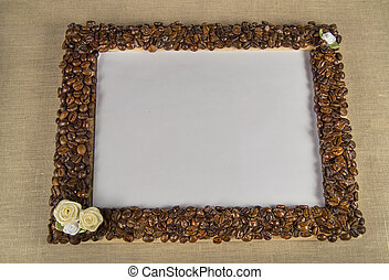 Coffee beans on a wooden frame. Empty space for your text