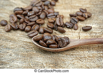Coffee beans on an old wooden background