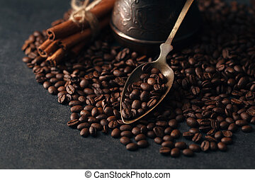 Coffee beans on black stone background