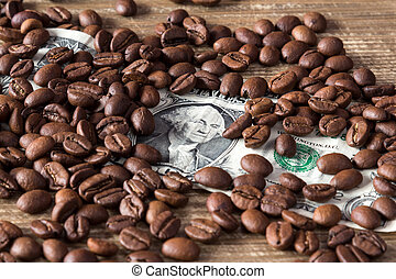 Coffee beans on dollar