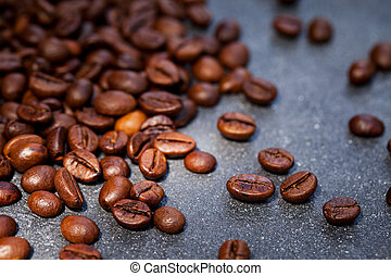 Coffee beans on grey slate background. Close up. Copy space.