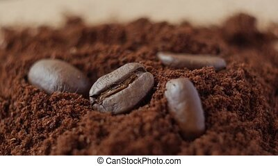 Coffee beans on ground coffee. - Coffee beans on ground...