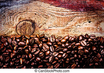 Coffee beans on old natural wooden background, macro. Brown Coff