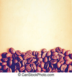 Coffee beans on old paper background with retro filter effect