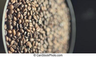 Coffee beans on rotating plate - Closeup shot of coffee ...
