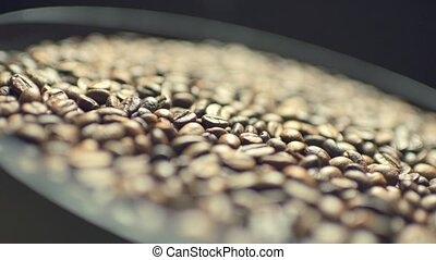 Coffee beans on rotating plate - Macro shot of coffee beans ...