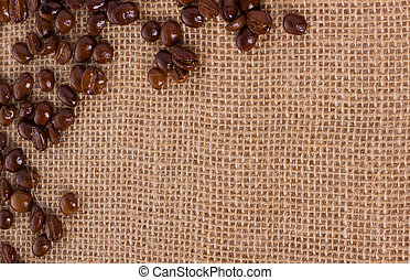 Coffee beans. On sackcloth, background