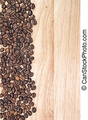 coffee beans on the background of wooden boards