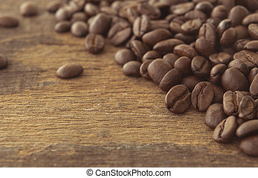 Coffee beans on the wooden floor grunge.