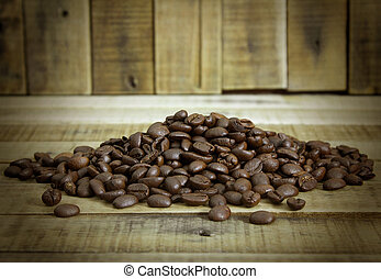 coffee beans on the wooden table background