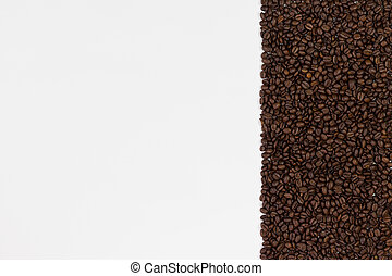 Coffee beans on white background. Top view with space for your text.