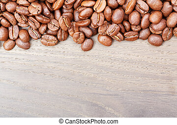Coffee beans on wood background. High resolution photo.