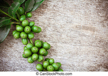 Coffee beans on wood background, Macro close-up for design work