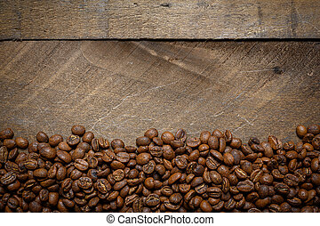 Roasted coffee beans on a vintage wood background