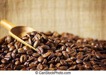 Coffee beans on wooden background. coffee seed.