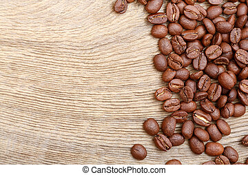 Coffee beans on wooden background. High resolution photo.