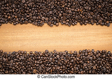 coffee beans on wooden background with copy space for text