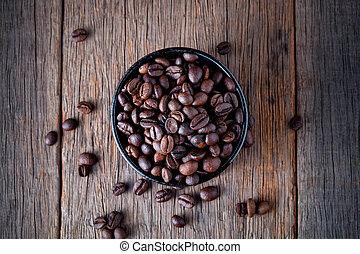 Coffee beans on wooden floor Popular drinks