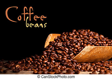 Coffee beans on wooden ladle
