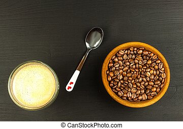 Coffee beans on wooden table.