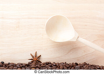 coffee beans on wooden table with wooden spoon