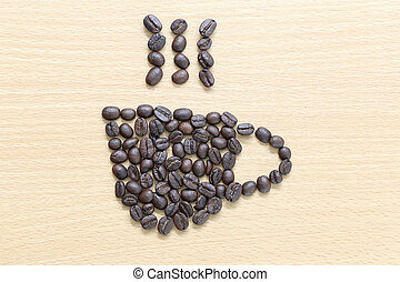 coffee beans Placed on the wood background in coffee cup shape.