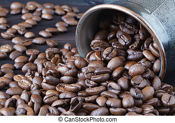 coffee beans roasted isolated on wooden background close up cut out in cup