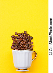 coffee beans spilled out of a cup