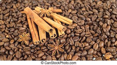 Coffee beans. Three anise stars. Lots of sticks of cinnamon. Sha