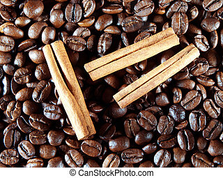 Coffee beans with cinnamon sticks on white