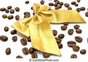 Coffee beans with golden gift bow