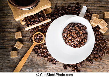 coffee beans with grinder and coffee cup - coffee beans with...