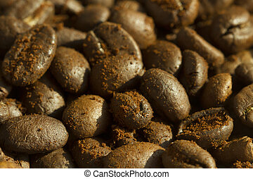 Coffee beans with ground coffee on it, background horizontal