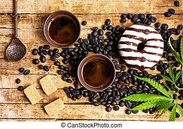Coffee beans with marijuana plant tabletop