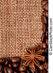 Coffee beans with spices on burlap sack