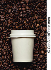 Coffee beans with white cup.