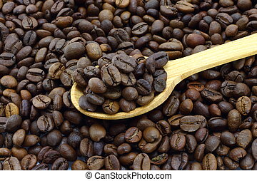 Coffee beans with wooden spoon