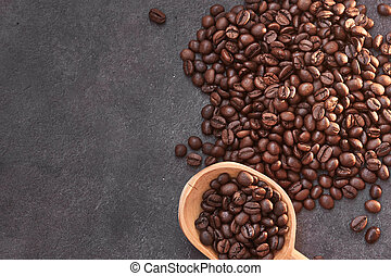 Coffee beans with wooden spoon on the table