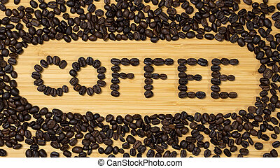 Coffee beans word on wooden background