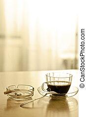 Coffee break and smoking a cigarette [in sepia tone]