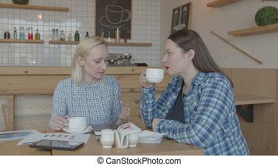 Coffee break of female freelancers working in cafe