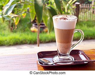 Coffee break with coffee latte in garden