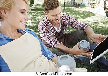Coffee break time with digital tablet