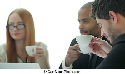 Coffee break with colleagues - Smiling businessman in a...