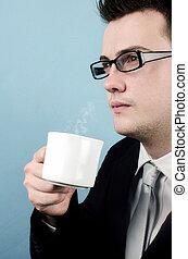 Coffee break - Young businessman taking a coffee break