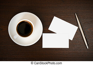 Coffee, business card and pen