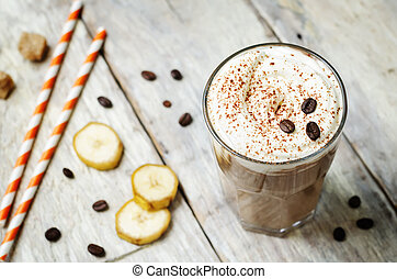 coffee chocolate banana smoothie with coconut whipped cream....