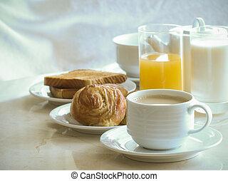 coffee, cinnamon roll, toast, milk and orange juice for breakfast.