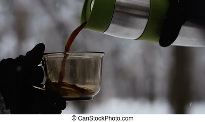 Coffee. Coffee and thermos on the background of the winter...