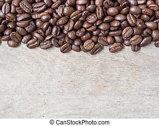 Coffee beans on the wooden floor